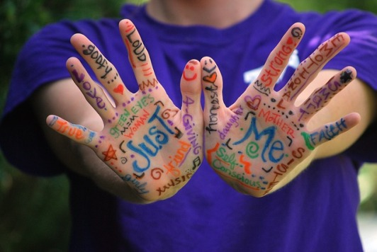 Words Painted on Child's Hands